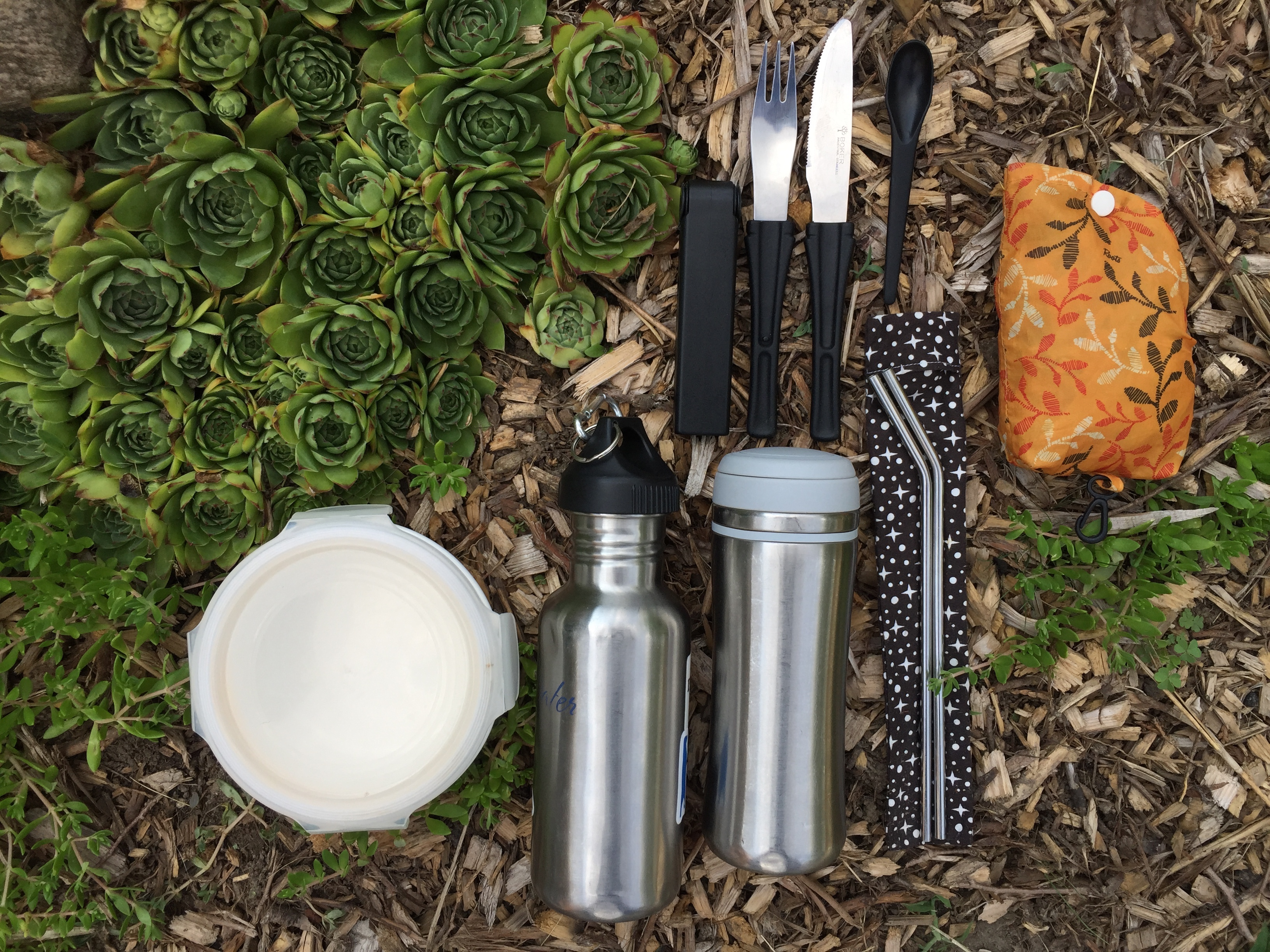 Reusable, stainless steel straws, mugs and bottles.